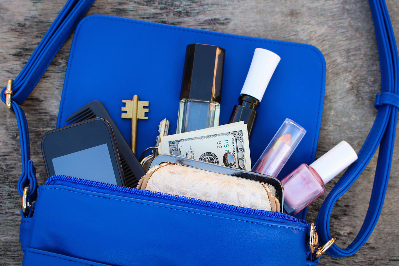 Blue women's purse. Things from open lady hand bag.