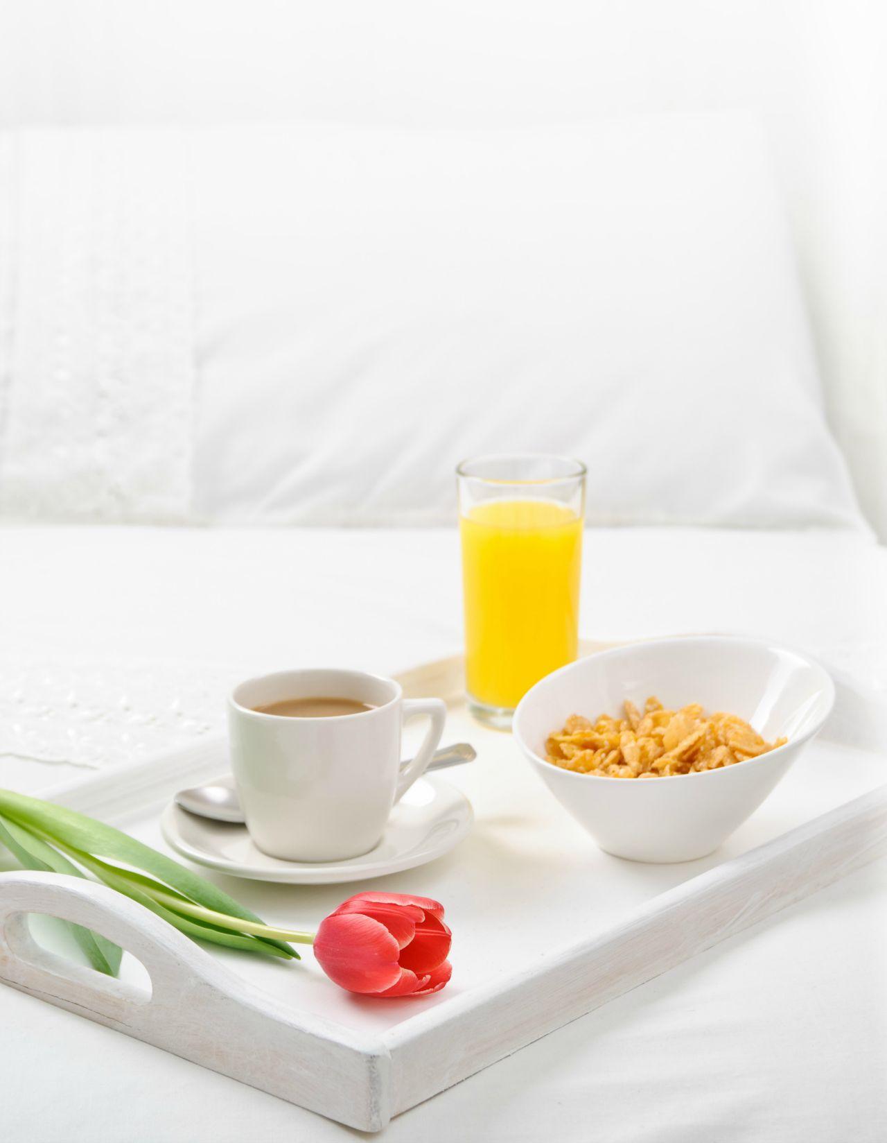 Breakfast tray on bed, high key, shallow dof