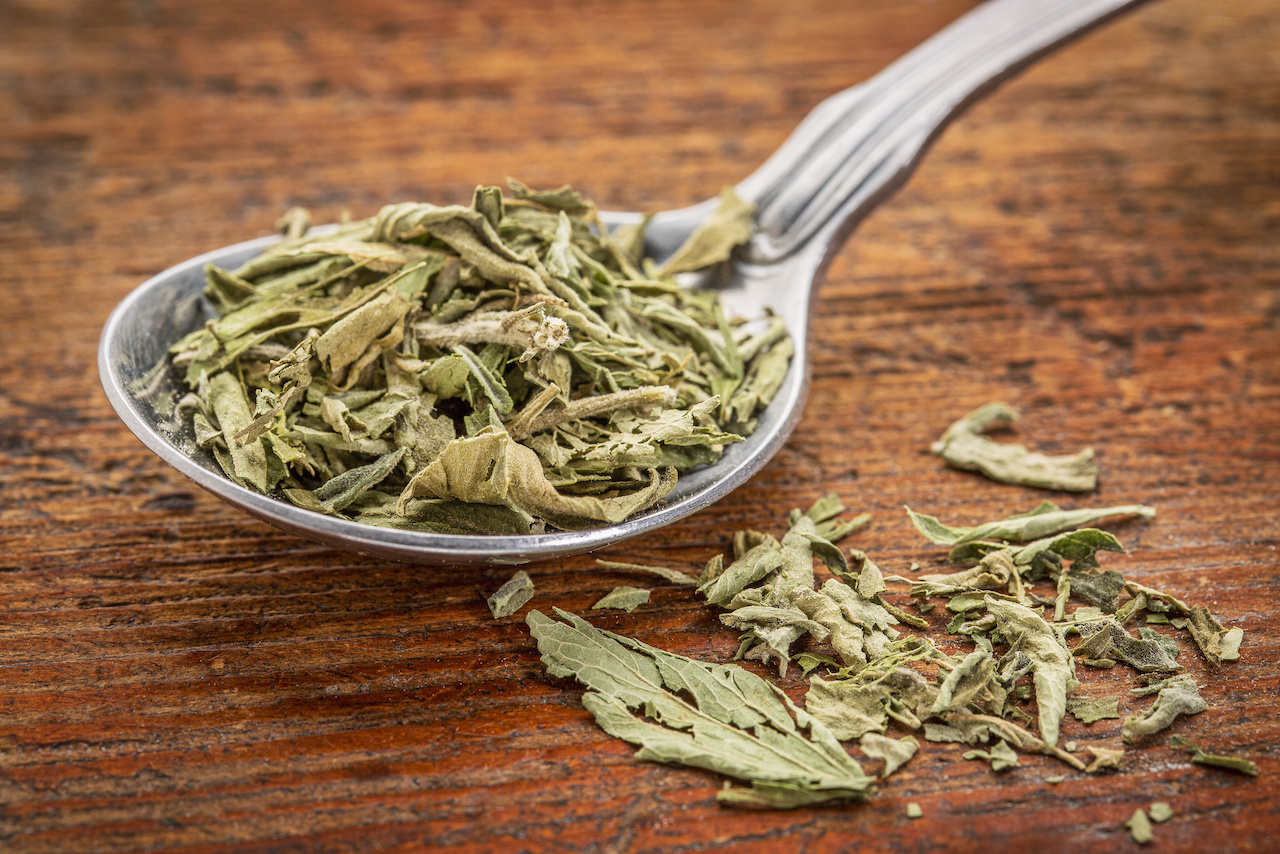 stevia dried leaves on tablespoon